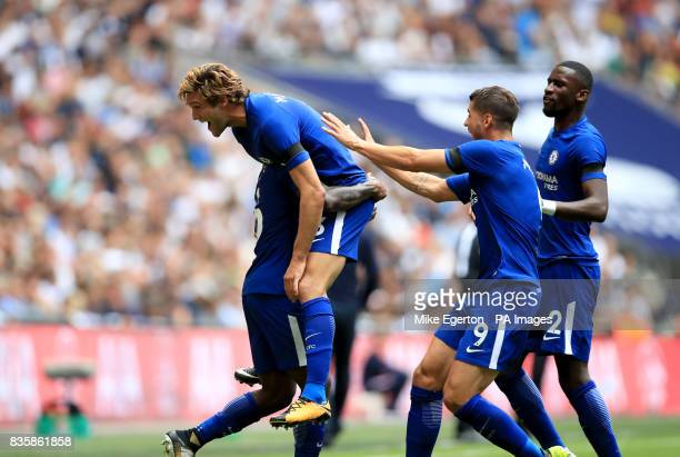 Chelsea's Marcos Alonso celebrates scoring his side's first goal of the game with teammates during the Premier League match at Wembley Stadium London