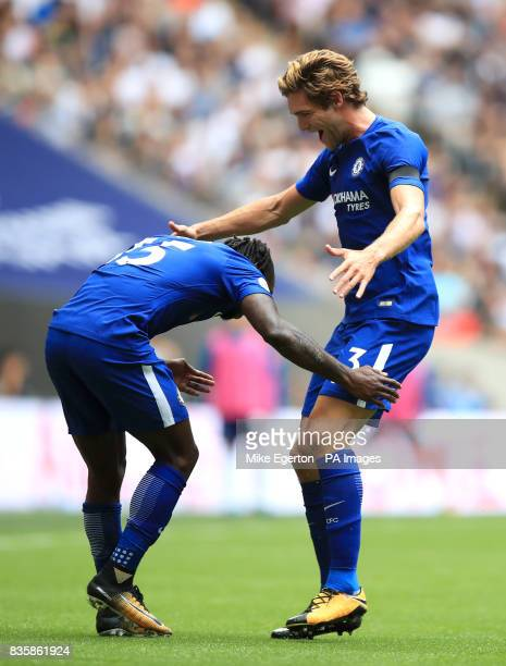 Chelsea's Marcos Alonso celebrates scoring his side's first goal of the game with teammate Victor Moses during the Premier League match at Wembley...