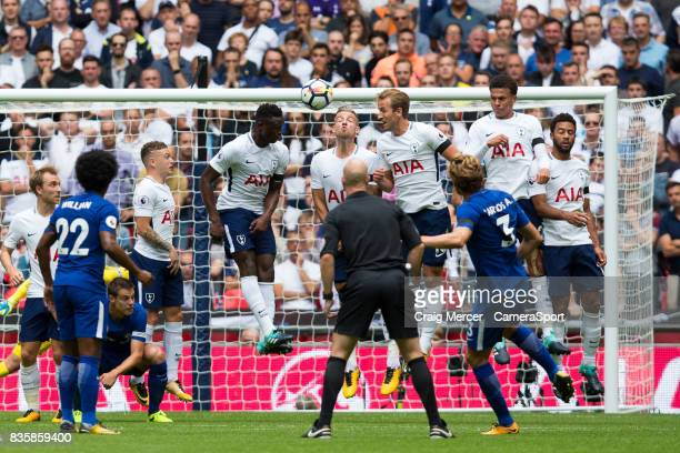 Chelsea's Marcos Alonso scores the opening goal from a freekick during the Premier League match between Tottenham Hotspur and Chelsea at Wembley...