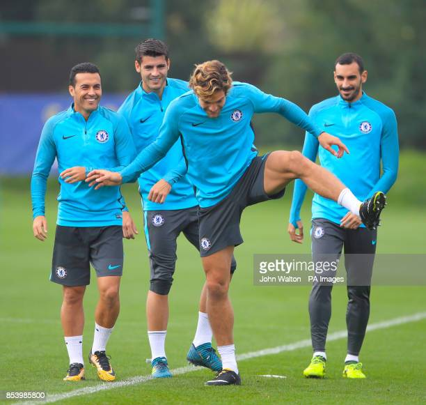 Chelsea's Marcos Alonso warms up as Chelsea's Pedro looks on during the training session at Cobham Training Ground