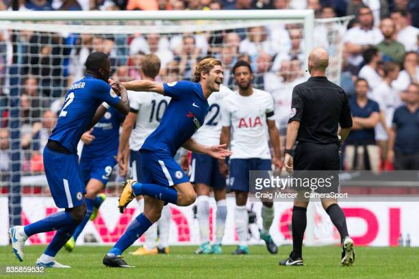 Chelsea's Marcos Alonso wheels away to celebrate scoring the opening goal during the Premier League match between Tottenham Hotspur and Chelsea at...