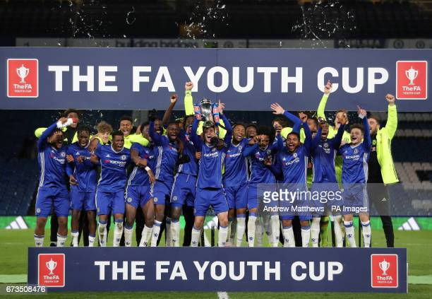 Chelsea's Mason Mount lifts the trophy as his teammates celebrate winning the FA Youth Cup Final Second Leg match at Stamford Bridge London
