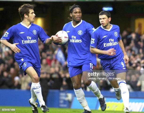 Chelsea's Mateja Kezman celebrates with teammates Joe Cole and Didier Drogba after scoring against Scunthorpe