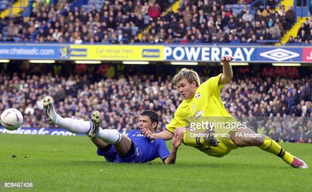 Chelsea's Mateja Kezman grapples with Scunthorpe's Andy Butler