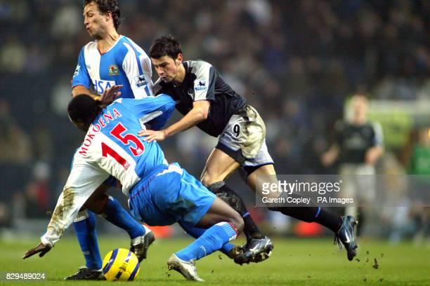 Chelsea's Mateja Kezman is blocked by Blackburn's Aaron Mokoena and Lucas Neill