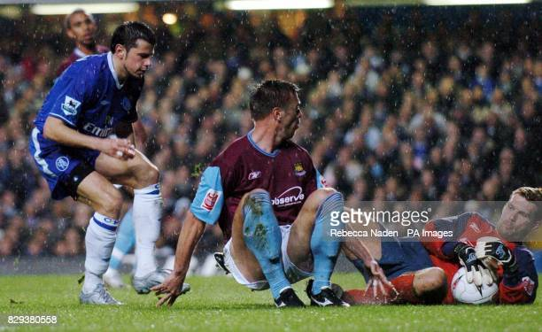 Chelsea's Mateja Kezman rues a missed chance as West Ham's goalkeeper Jim Walker holds the ball with Tomas Repka looking on during the match at the...