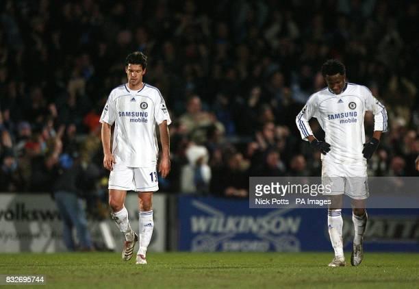 Chelsea's Michael Ballack amd John Mikel walk back dejected following conceeding a goal