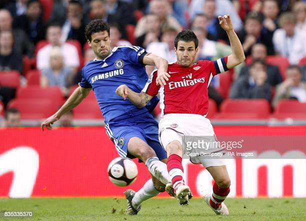 Chelsea's Michael Ballack and Arsenal's Francesc Fabregas battle for the ball