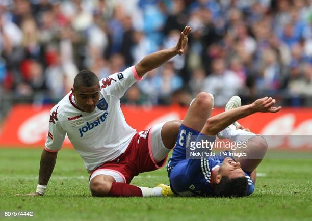 Chelsea's Michael Ballack reacts after being challenged by Portsmouth's KevinPrince Boateng