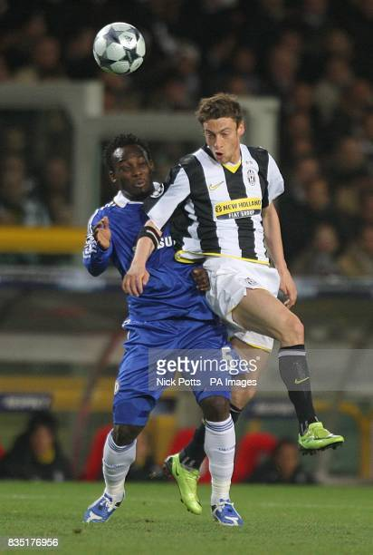 Chelsea's Michael Essien and Juventus' Claudio Marchisio battle for the ball