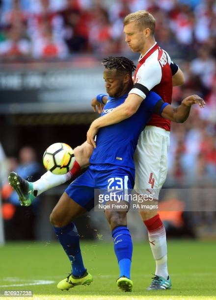 Chelsea's Michy Batshuayi and Arsenal's Per Mertesacker battle for the ball during the Community Shield at Wembley London