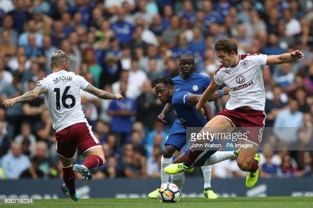 Chelsea's Michy Batshuayi and Burnley's James Tarkowski battle for the ball during the Premier League match at Stamford Bridge London