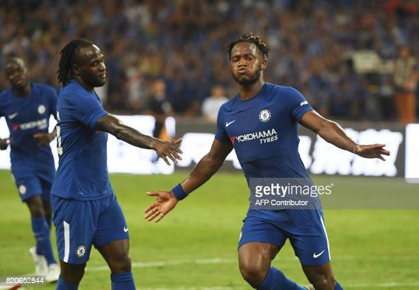 Chelsea's Michy Batshuayi celebrates after scoring against Arsenal during their preseason friendly football match at Beijing's National Stadium known...