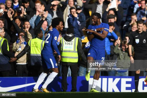 Chelsea's Michy Batshuayi celebrates scoring his side's fourth goal of the game with teammate Willian during the Premier League match at Stamford...