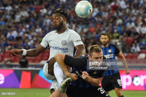 Chelsea's Michy Batshuayi fights for the ball with Inter Milan's Danilo D'Ambrosio during their International Champions Cup football match in...
