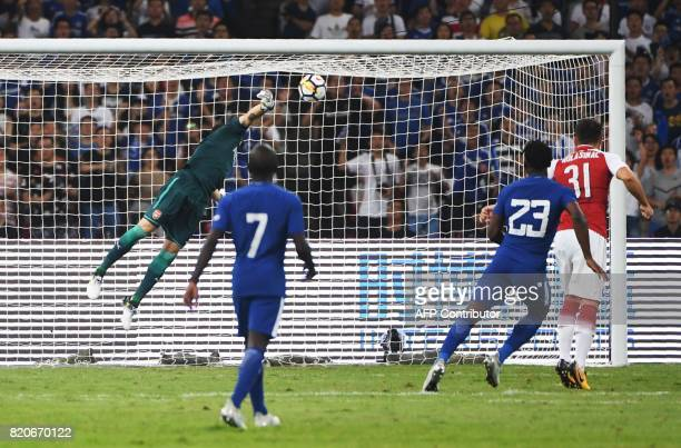 Chelsea's Michy Batshuayi scores against Arsenal during their football match in Beijing's National Stadium known as the Bird's Nest on July 22 2017 /...