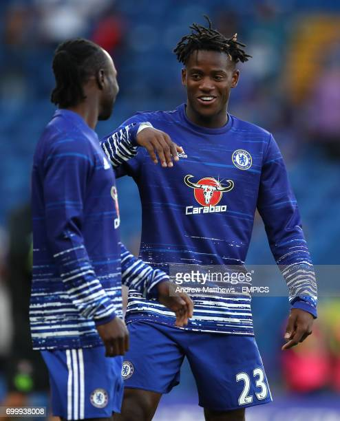 Chelsea's Michy Batshuayi shares a joke with Victor Moses