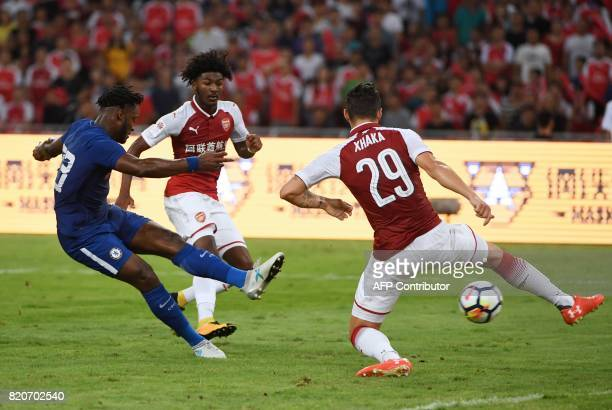 Chelsea's Michy Batshuayi shoots past Arsenal's Granit Xhaka during their preseason football match in Beijing's National Stadium known as the Bird's...
