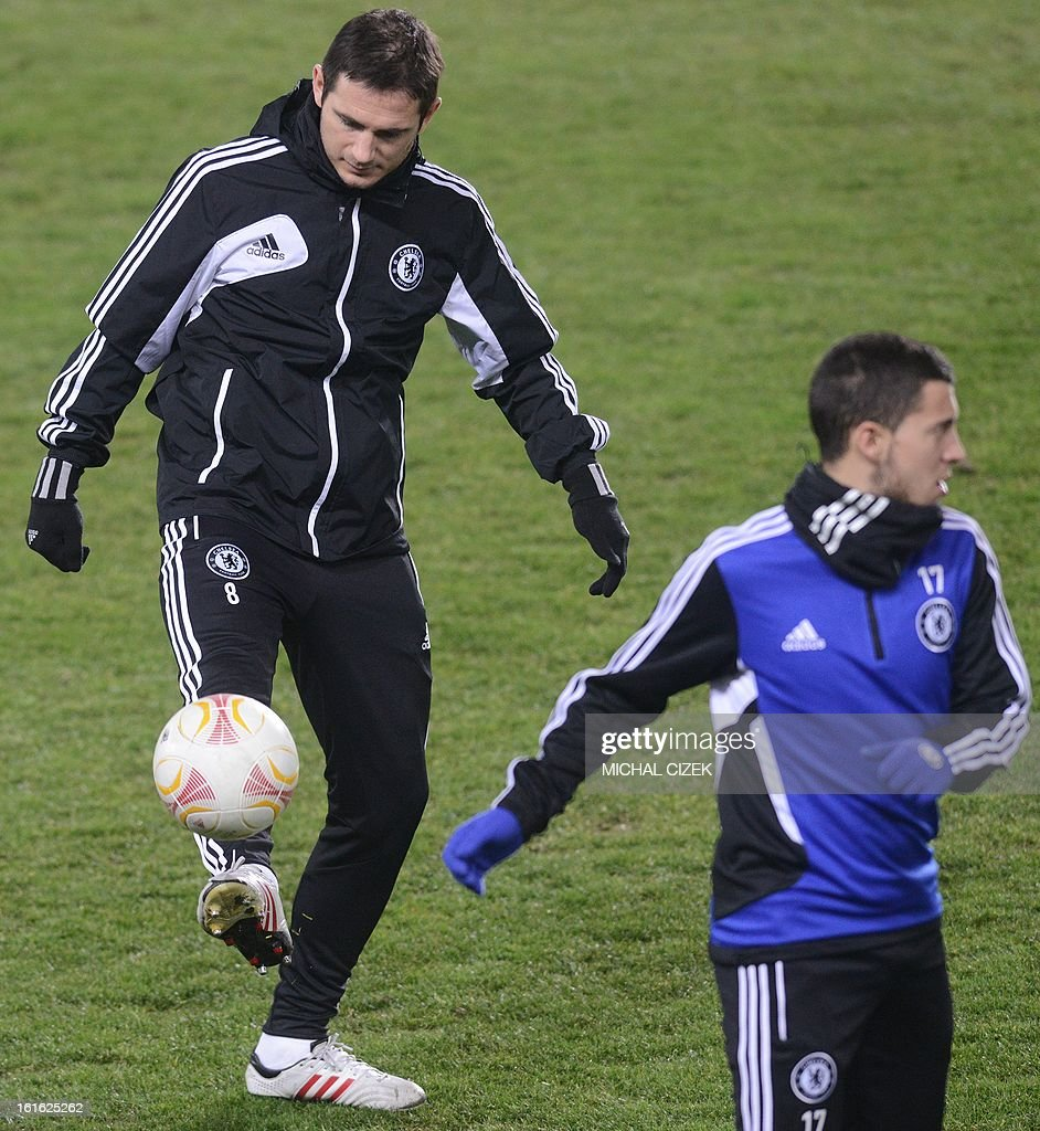 Chelsea's midfielder Frank Lampard (L) plays the ball during a training session at the Letna Stadium in Prague on February 13, 2013. Sparta Prague will play vs FC Chelsea in a Europaleague football match on February 14, 2013 in Prague.