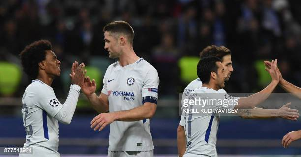 Chelsea's midfielder from Brazil Willian celebrates after scoring the team's fourth goal during the UEFA Champions League Group C football match...
