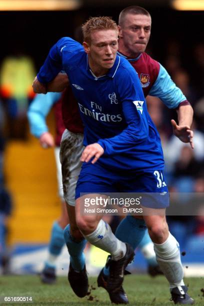 Chelsea's Mikael Forssell shakes off the attention of West Ham United's Tomas Repka