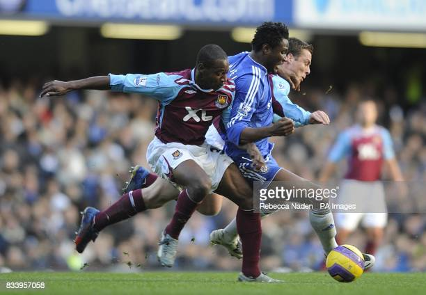 Chelsea's Mikel John Obi holds off West Ham United's Luis Boa Morte and Scott Parker as they battle for the ball