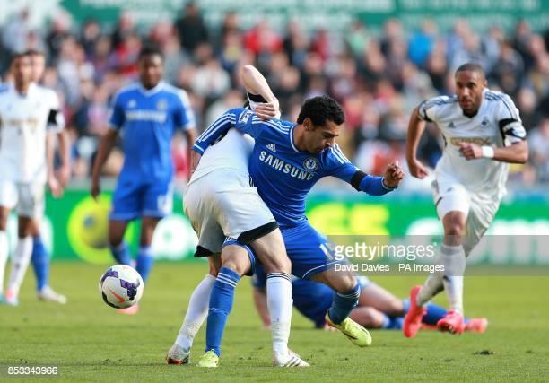 Chelsea's Mohamed Salah and Swansea City's Ben Davies battle for the ball