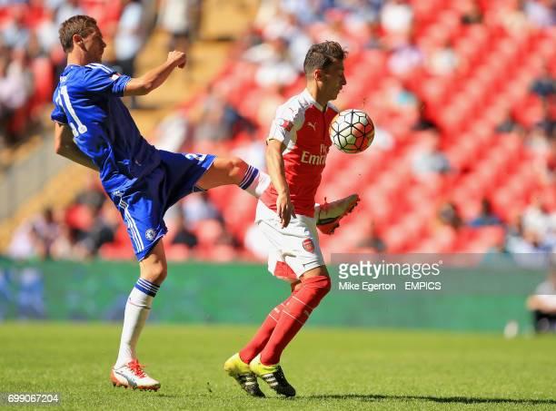 Chelsea's Nemanja Matic and Arsenal's Mesut Ozil in action