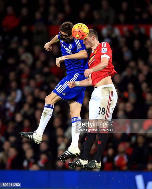 Chelsea's Nemanja Matic and Manchester United's Morgan Schneiderlin battle for the ball in the air
