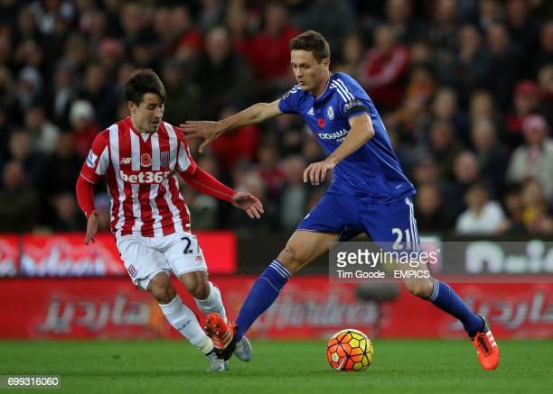 Chelsea's Nemanja Matic and Stoke City's Bojan Krkic battle for the ball