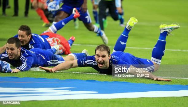 Chelsea's Nemanja Matic Eden Hazard and Branislav Ivanovic dive on the pitch whilst celebrating their win