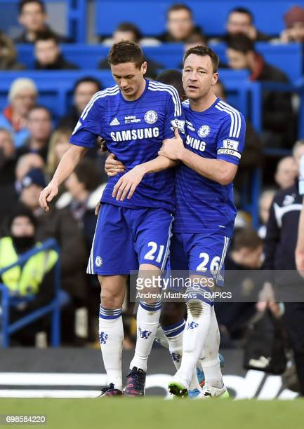 Chelsea's Nemanja Matic is held back by team mate John Terry as tempers flare after a foul by Burnley's Ashley Barnes