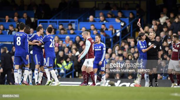 Chelsea's Nemanja Matic is shown a red card by referee Martin Atkinson for fighting after tempers flare with Burnley's Ashley Barnes