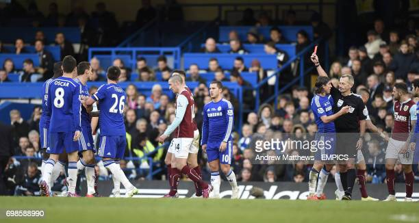 Chelsea's Nemanja Matic is shown a red card by referee Martin Atkinson for pushing Burnley's Ashley Barnes