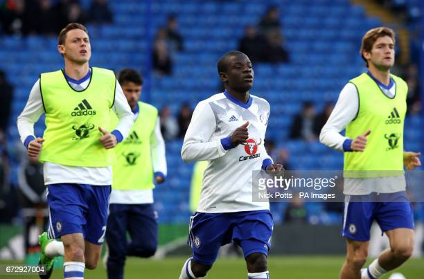 Chelsea's Nemanja Matic N'Golo Kante and Marcos Alonso warm up before the Premier League match at Stamford Bridge London