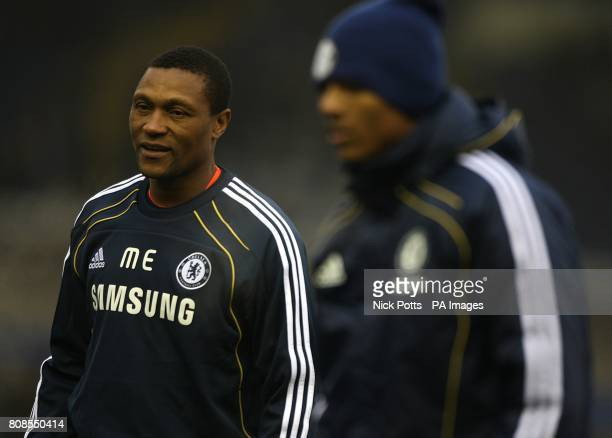 Chelsea's new assistant first team coach Michael Emenalo watches over the pre match warm up