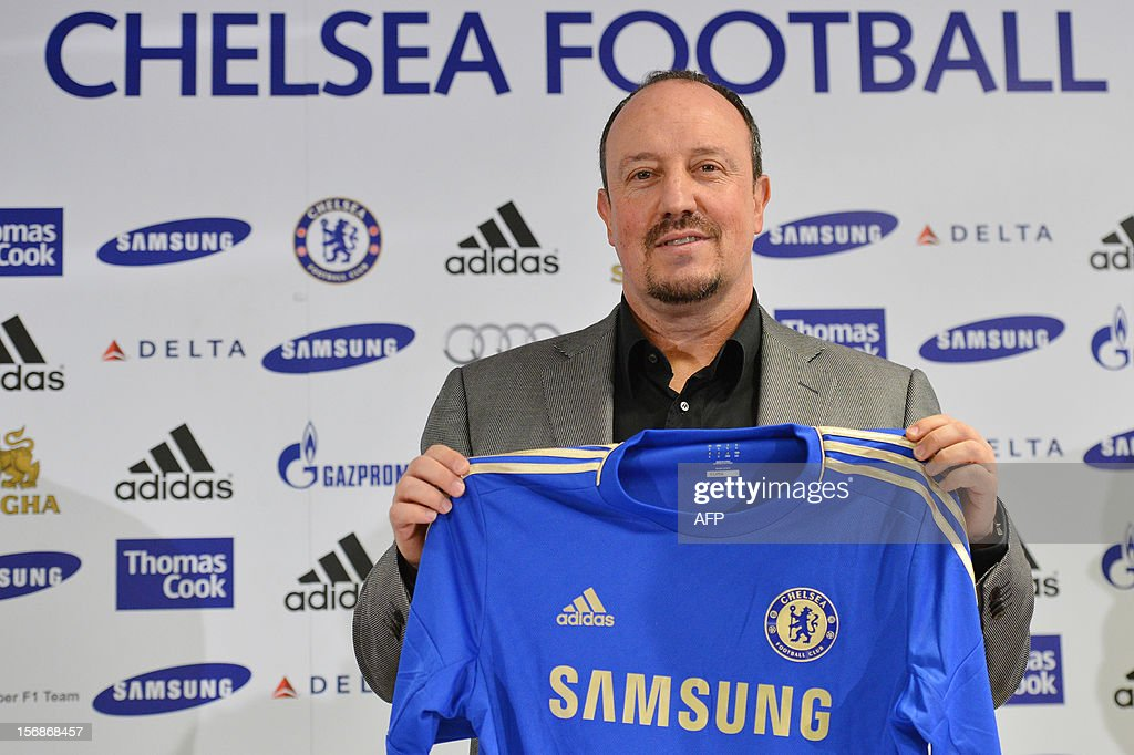 Chelsea's new interim manager Spain's Rafael Benitez holds up a Chelsea jersey during a press conference at Stamford Bridge in London on November 22, 2012. Benitez tried to overcome hostility from Chelsea fans angry with his appointment as interim manager by insisting both he and they wanted the same things. The Spaniard started life with the European champions on November 22 after the London club sacked its Italian manager Roberto di Matteo. AFP PHOTO / BEN STANSALL