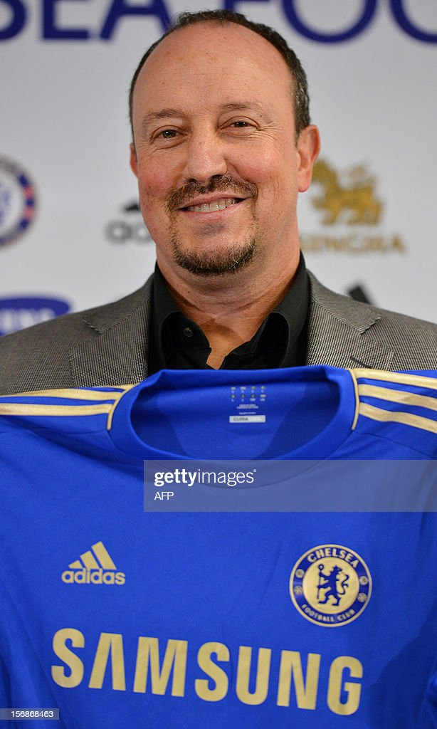 Chelsea's new interim manager Spain's Rafael Benitez holds up a Chelsea jersey during a press conference at Stamford Bridge in London on November 22, 2012. Benitez tried to overcome hostility from Chelsea fans angry with his appointment as interim manager by insisting both he and they wanted the same things. The Spaniard started life with the European champions on November 22 after the London club sacked its Italian manager Roberto di Matteo.