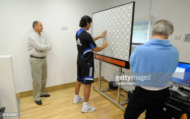 Chelsea's new manager Luiz Felipe Scolari stands beside Claudio Pizarro during a medical test July 7 2008 in Cobham England