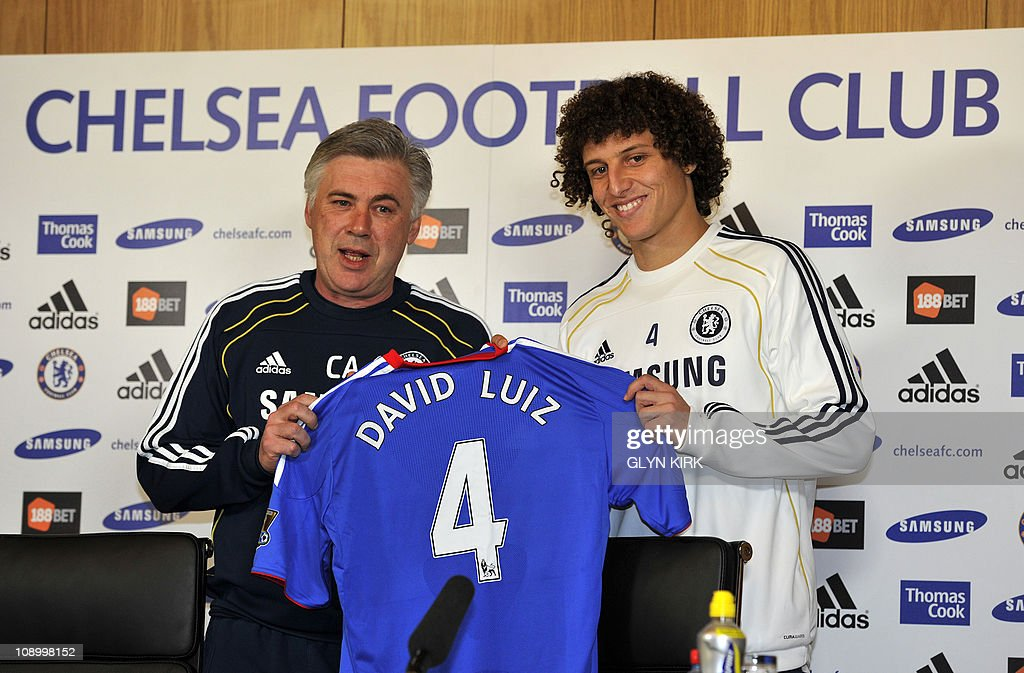 Chelsea's new signing Brazilian defender David Luiz is pictured with Italian Manager Carlo Ancelotti during a press conference at Chelsea's training...