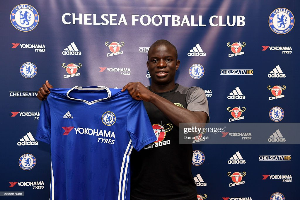 Chelsea's new signing N'Golo Kante poses for a photo with the club shirt during the club's pre-season US tour at Loews Hotel on August 3, 2016 in Minneapolis, Minnesota.