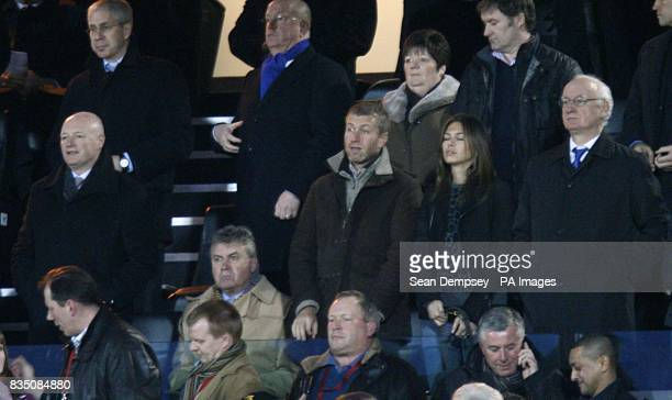 Chelsea's new temporary head coach Guus Hiddink with club director Peter Kenyon owner Roman Abramovich and girlfriend Daria Zhukova and chairman...