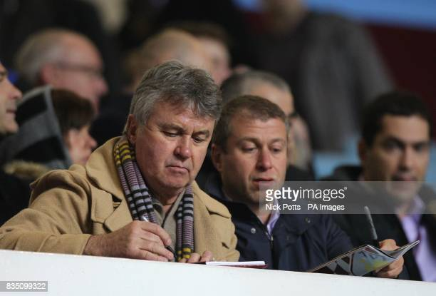 Chelsea's new temporary head coach Guus Hiddink with club owner Roman Abramovich sign autographs in the stand
