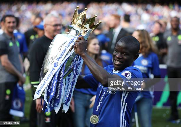Chelsea's N'Golo Kante celebrates with the trophy after the Premier League match at Stamford Bridge London