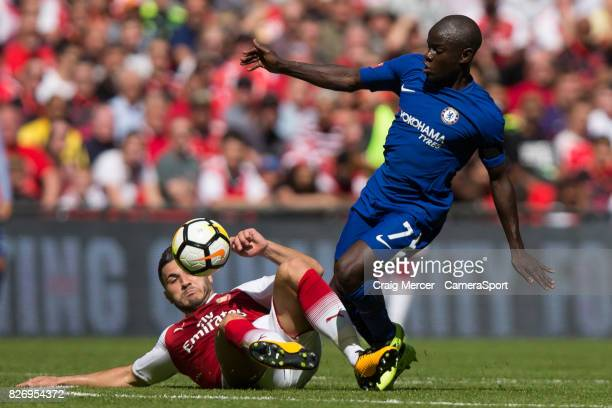 Chelsea's N'Golo Kante evades the challenge of Arsenal's Sead Kolasinac during the FA Community Shield match between Arsenal and Chelsea at Wembley...