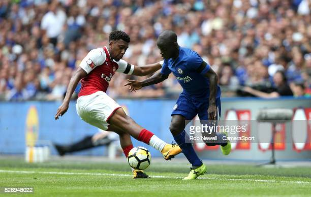 Chelsea's N'Golo Kante gets past Arsenal's Alex Iwobi during the FA Community Shield match between Arsenal and Chelsea at Wembley Stadium on August 6...