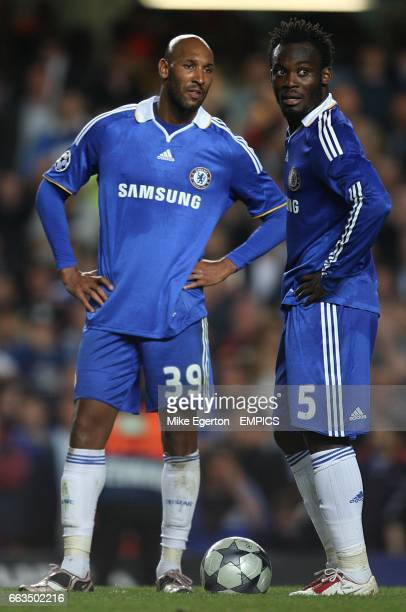 Chelsea's Nicolas Anelka and Michael Essien stand dejected after Andres Iniesta scores the equaliser