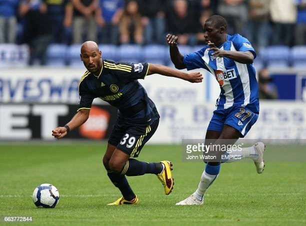 Chelsea's Nicolas Anelka and Wigan Athletic's Mohamed Diame battle for the ball