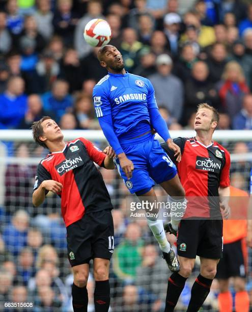 Chelsea's Nicolas Anelka rises above Blackburn Rovers' Morten Gamst Pedersen and Vincenzo Grella to win the header