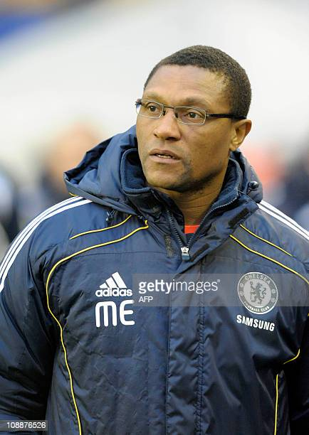 Chelsea's Nigerian first team assistant coach Michael Emenalo looks on before the English Premier League football match between Birmingham City and...